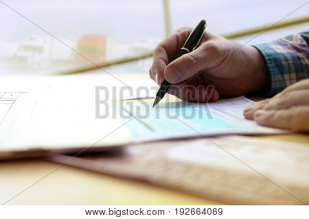 driver writing log books sitting on a table