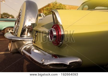 classic retro vintage yellow car. Car spare wheel. The car is older than 1985