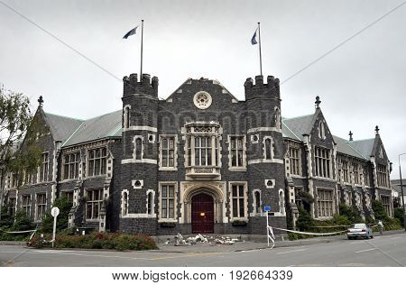Dark Clouds Hang over The Peterborough Centre Building in Christchurch. This historic Christchurch New Zealand building Originally the Teachers' College Building was badle damaged in recent Eathquakes.