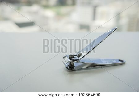 close up isolated nail clipper on table for beauty and healthcare