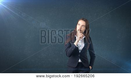 Young Businesswoman Portrait In Suit Standing And Finger Up Near Her Lips With Hush Sign, Background