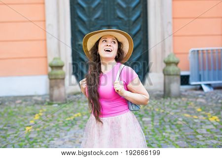 fashion, happiness and lifestyle concept - beautiful woman in hat enjoying summer outdoors.