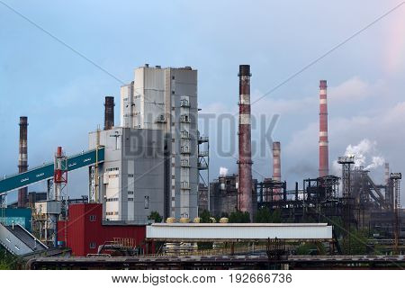 LIPETSK, RUSSIA - JUNE , 2017: Metallurgical plant NLMK Group. Manufacture of cast iron and steel. A lot of factory pipes. Air pollution.