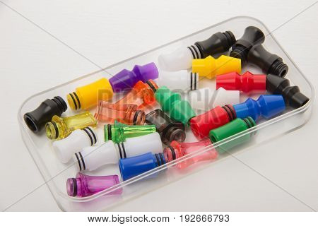 Mouthpieces different colors for electronic cigarettes on a white background