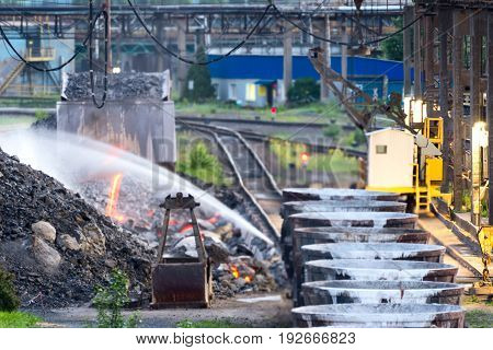 LIPETSK, RUSSIA - JUNE , 2017: Metallurgical plant NLMK Group. Freight railroad train with bowls of molten metallurgical slag. Factory slag.