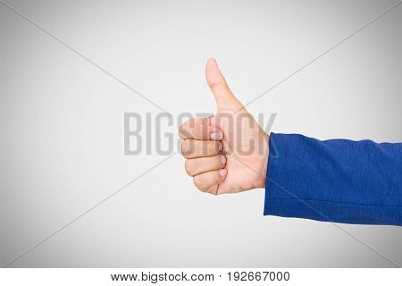 Businessman's hand with thumb up on white background.