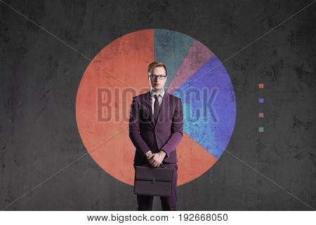 Business man standing on a diagram background. Business, office, career, concept.