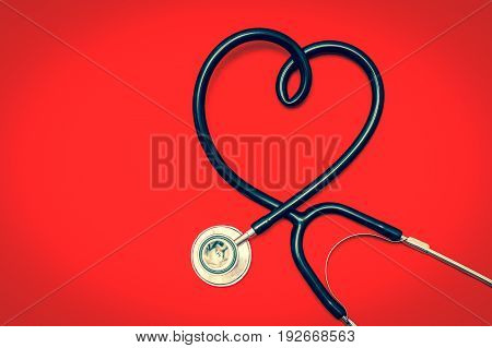Stethoscope In Shape Of Heart Isolated On Red Background