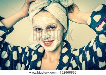 Attractive woman applying natural facial mask from sour cream - retro style