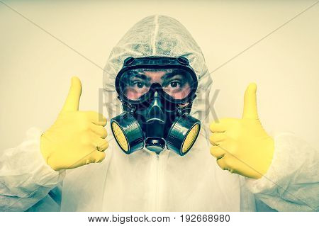 Man In Coveralls With Gas Mask Is Showing Positive Gesture