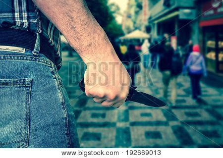 Killer Is Attacking With Knife On Crowd Of People In Public Plac