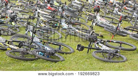 STOCKHOLM SWEDEN - JUNE 11 2017: Lots of mountainbikes laying in the grass before the start in the race at Lida Loop Mountainbike Race. June 11 2017 in Stockholm Sweden