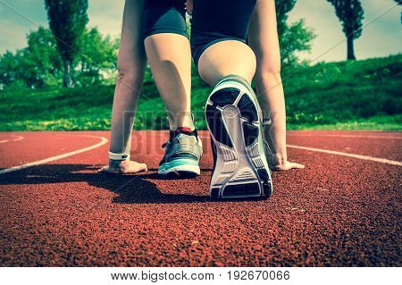 Athlete Woman At Starting Line Ready To Run