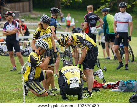 STOCKHOLM SWEDEN - JUNE 11 2017: Mountain bike team fixing the bike before the start in the race cycling at Lida Loop Mountainbike Race. June 11 2017 in Stockholm Sweden