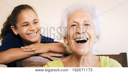 Happy Old Senior Woman Grandmother And Young Girl Smiling
