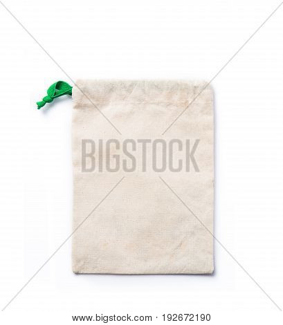 light brown small sack with green pull string laying flat on white background empty space for adding text or graphics