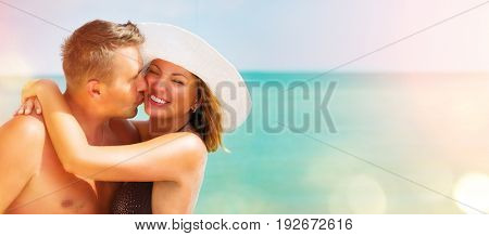 Middle aged Couple together on the Beach. Ocean or Sea. Travel and Vacation concept. Happy Family Relaxing and Enjoying romantic Tropical Summer Holidays, kissing, hugging together. Sunbathing. Travel