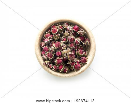 Exotic and delicious tea, roses buds in rustic bowl, red and aromatic tea, loose, topview