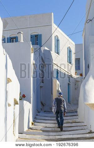 ARTEMONAS, GREECE - MAY 20, 2017: Street with typical Cycladic architecture in Artemonas village on Sifnos island in Greece on May 20, 2017.