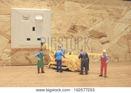 Miniature People In Engineer Or Worker Occupation