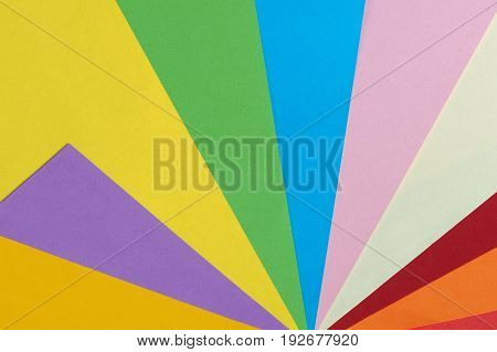 Colored paper background in a fan pattern