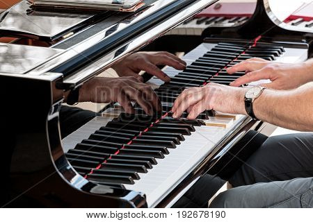 Pianist Hands Closeup. Professional Musician Playing The Piano.