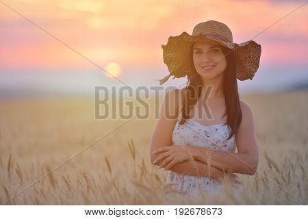 Closeup Portrait Of Smiling Young Caucasian Woman In Nature. Cheerful Young Beautiful Woman Enjoying