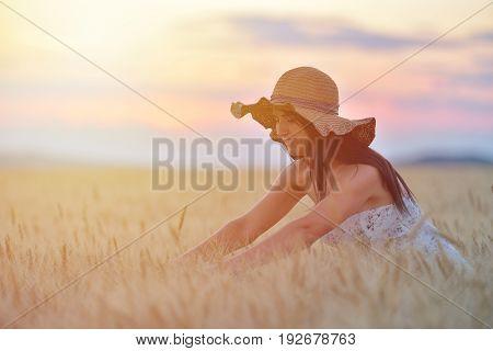Closeup Portrait Of Smiling Young Caucasian Woman In Nature. Cheerful Young Beautiful Woman Touching
