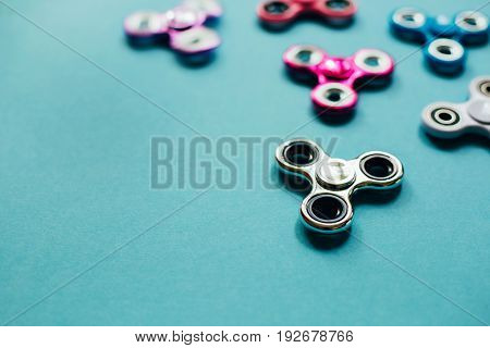 Set of fidget spinners on blue background.