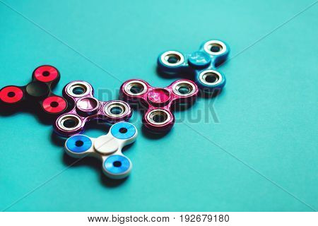 Set of fidget spinners on blue background. The most popular toy of the year. Worldwide trend.