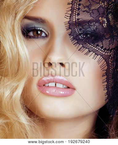 portrait of beauty young woman through lace close up mistery makeup sexy, fashion people concept close up