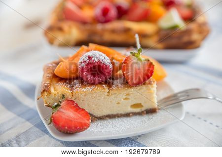 home made vanilla cheesecake with strawberries and apricot