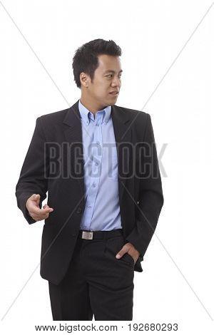 Asian businessman looking left, walking, gesturing.