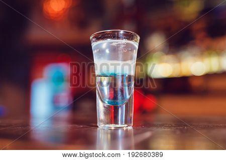 Alcohol shot Hiroshima on the bar. Alcoholic beverages.