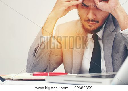 Feeling Sick And Tired From Working. Frustrated Young Man Are Stressed While Sitting At His Working