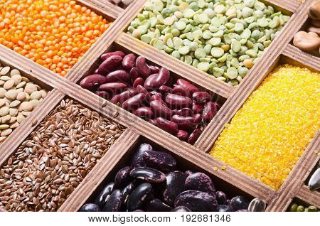 Colorful cereals and beans in wooden box