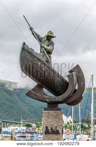 Statue Of A Whaler In A Boat  In Main Square In Tromso, Norway.