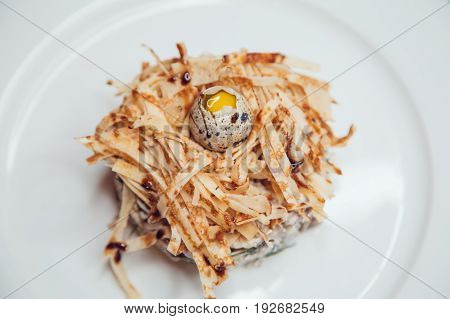 Salad in the form of a nest and decorated with quail eggs.