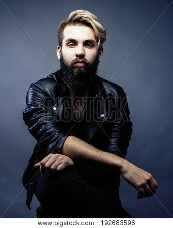 portrait of young bearded hipster guy smiling on gray dark background close up, brutal modern man, lifestyle people concept close up