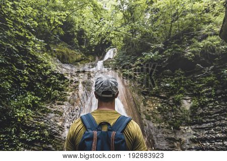 Traveler Has Reached The Destination Enjoying View Of Waterfall And Beauty The Unspoilt Nature. Contemplation Adventure Concept
