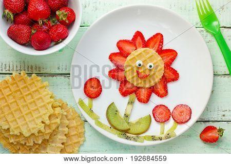 Fun with food - strawberry kiwi waffle flower for kids