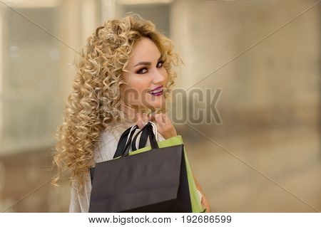 Happy Young Woman With Shopping Bags In Mall Turned Round.