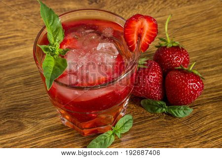 Strawberry Iced Drink In A Wooden Table