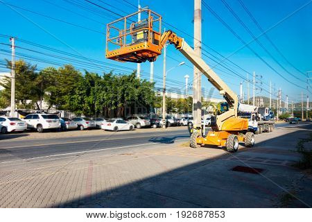Lifting boom lift in construction site., Heavy equipment.