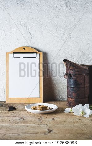 Flowers, Smoker And Tools On A Wooden Table Against The Background Of A Light Wall. Concept Of An Ap