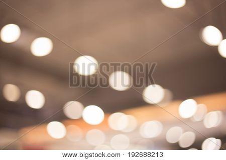indoor abstract bokeh background of yellow lights.