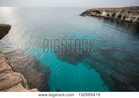 Rock cliffs and sea bay with azure water near Protaras, Cyprus island