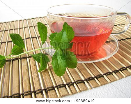 Cup of tea with zero calorie, sweetened with stevia leaves