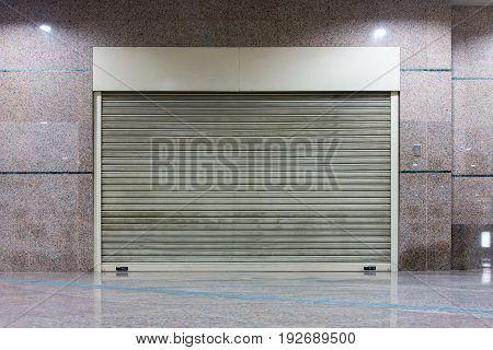 Roller shutter door and wall granite background.