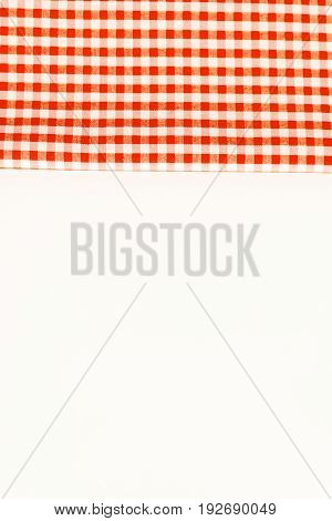 Orange cloth, a kitchen towel with a checkered pattern, on a white background isolated.